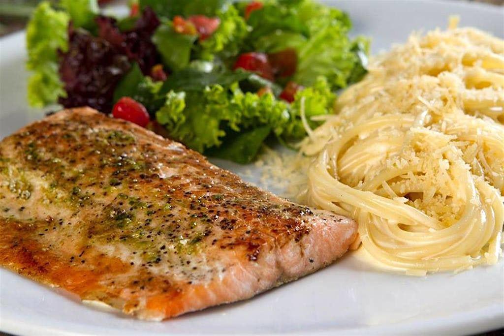 Il Forno Salmon with Alfredo pasta and salad, photo courtesy of Il Forno